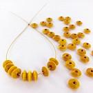 Houten kralen discus 7mm geel