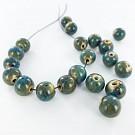 Kralen 12mm turquoise rond porselein